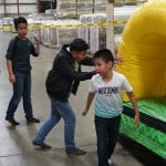 Kids playing at the Hamilton Plastics Christmas Party