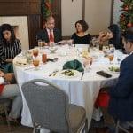 Family eating at the Hamilton Plastics Christmas Party
