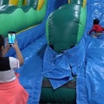 Kids playing at the Hamilton Plastics Christmas Party in a Bounce House.